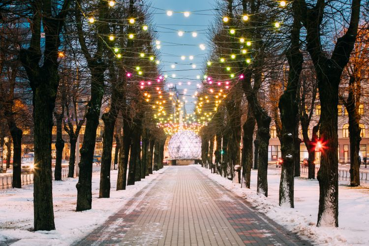 Riga, Latvia. Evening View Of Esplanade Park On Freedom Street Decorated With Festive Christmas Xmas New Year Illuminations.