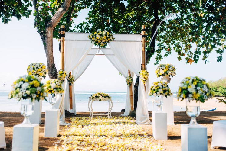 Wedding preparation, setting details. Romantic ceremony on beach with ocean background